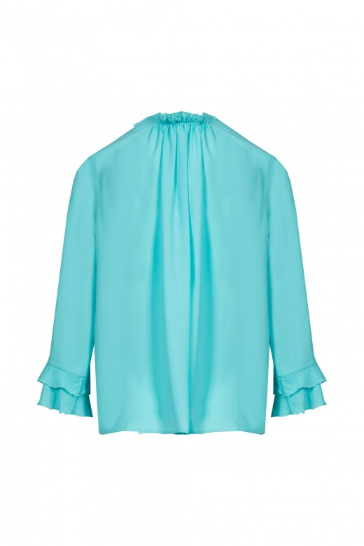 Double frill tunic on the sleeve