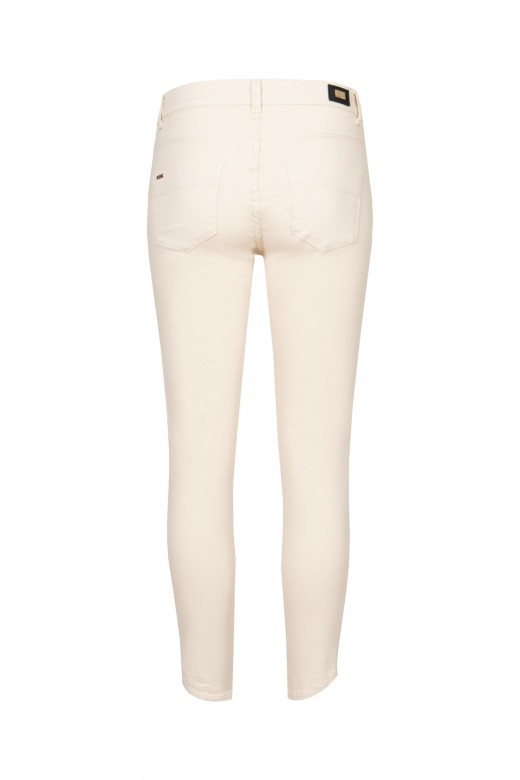 Skinny pants with spiked hem