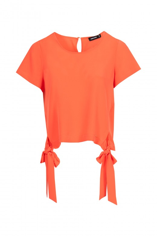 Tunic with side openings.