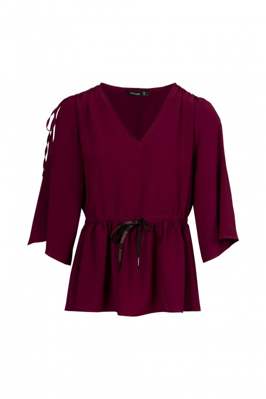 Tunic with sleeve opening
